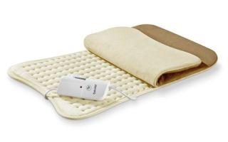 Грелка для новорожденного от колик: виды и правила применения